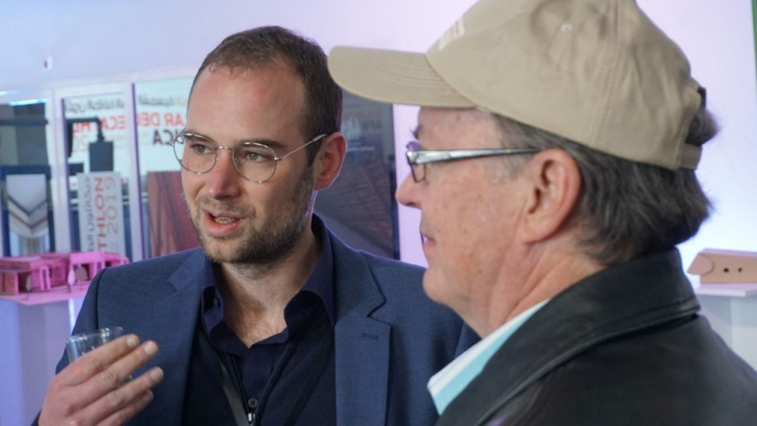 Photo of Dr. Lorberg speaking with Richard King.