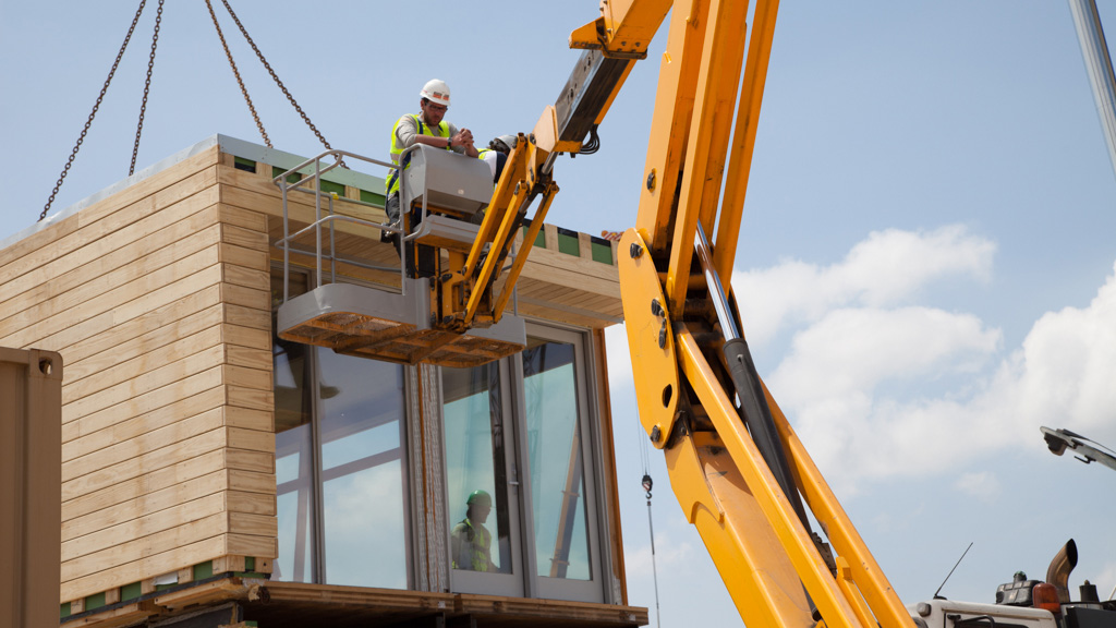 Man on a crane at a building site